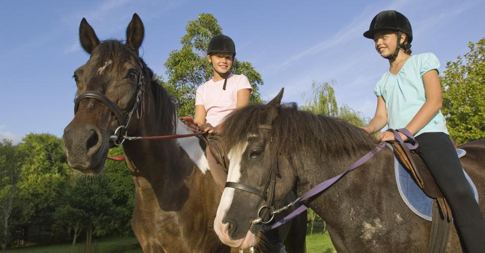 Girls riding ponies